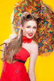 Pin-up girl with umbrella — Stock Photo