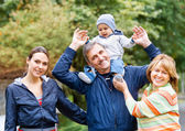 Smiling family and grandparents in the countryside — Foto Stock