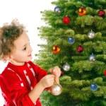 Girl dresses up a christmas-tree — Stock Photo #6050050