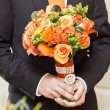 Groom and flowers — Stock Photo