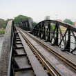 Death Railway between Thailand and Burma.Bridge though river Kwa - Stock Photo