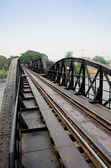 Death Railway between Thailand and Burma.Bridge though river Kwa — Stock Photo