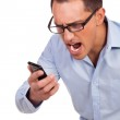 Young man shouts at his mobile phone — Stock Photo #19861535