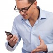 Man annoyed by his mobile phone — Stock Photo #20232357