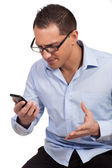 Man annoyed by his mobile phone — Stock Photo