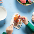 Child painting Easter eggs — Stock Photo #21332775