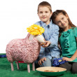 Brother and sister feeding a sheep — Stock Photo
