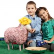 Brother and sister feeding a sheep - Stock Photo