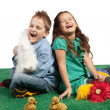 Young boy and girl laughing together - Stock Photo