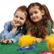 Happy children with Easter chicks - Stock Photo