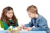 Brother and sister decorating Easter eggs — Stock Photo
