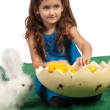 Young girl with egg shape and chicks inside - Stock Photo