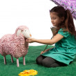 Young girl with purple parasol and toy lamb - Stock Photo