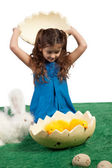 Young girl with egg shape and chicks inside — Stock Photo