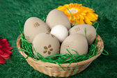 Basket of Easter eggs with painted patterns — Stock Photo