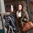 Urban scene with two young women shopping — Stock Photo #22143157
