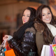 Two beautiful happy shoppers - Stock Photo