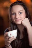 Beautiful thoughtful woman drinking coffee — Stock Photo