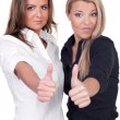 Women thumbs up - Foto Stock