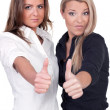 Women thumbs up - Stockfoto
