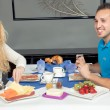 Stock Photo: Couple enjoying hearty breakfast