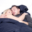 Young couple sleeping peacefully in bed — Stock Photo