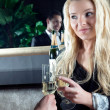 Beautiful woman toasting her partner - Stock Photo