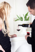 Man pouring a glass of red wine — Stock Photo