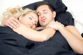 Affectionate couple enjoying a blissful sleep — Stock Photo