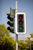 Traffic light with green light illuminated — Stock Photo