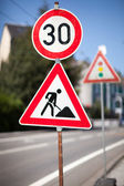 Traffic sign for roadworks ahead — Stock Photo