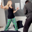Young couple having a pillow fight — Stok fotoğraf