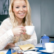 Pretty woman enjoying her breakfast — Stock Photo