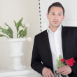 Romantic man with a red rose — Stock Photo