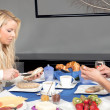 Couple enjoying breakfast together at home — Stock Photo