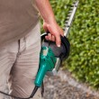 A Man cuts the hedge by the Hedge trimmer — Stock Photo