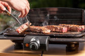 Smoking steak — Stock Photo