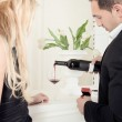 Man pouring glasses of red wine — Stock Photo