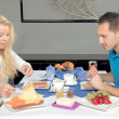 Attractive young couple enjoying breakfast — Stock Photo