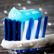 Stock Photo: Glowing toothpaste