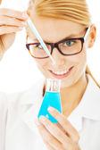 Scientist Mixing Chemical In Beaker — Stock Photo