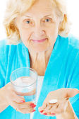 Senior Woman With Water Glass And Tablet — Stock Photo