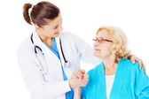 Female Doctor Consoling Senior Woman — Stock Photo