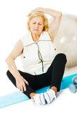 Senior Woman Exercising On Mat — Stock Photo