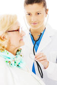 Doctor Examining Senior Woman With Stethoscope — Stock Photo