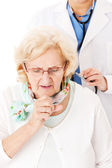 Senior Woman Coughing While Doctor Examining Her — Photo