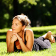 Young woman lying in the park — Stock Photo #3925169
