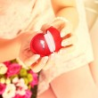 Woman holding engagement ring — Stock Photo
