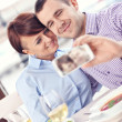 Young couple taking a picture in a restaurant — Stock Photo
