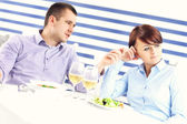 Couple having argument in a restaurant — Stok fotoğraf